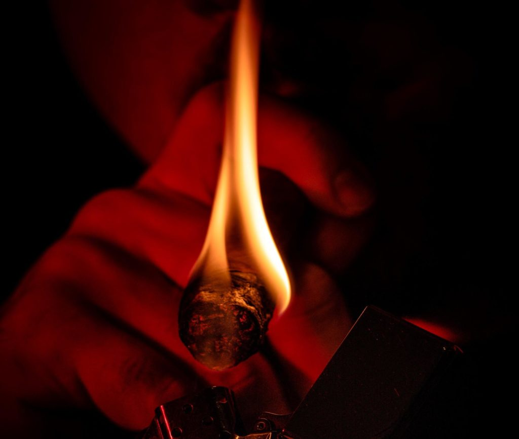 upclose of a flame of some one smoking a blunt